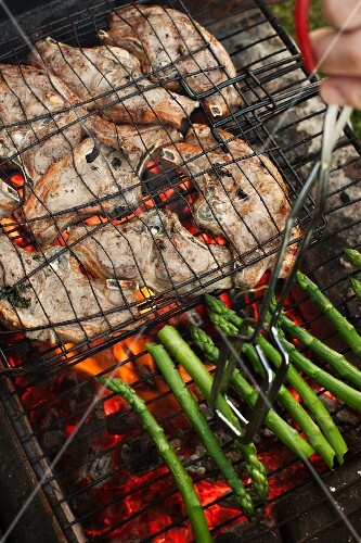 Lamb chops and asparagus on a barbecue