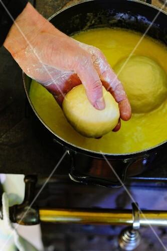 Yeast dumplings being prepared