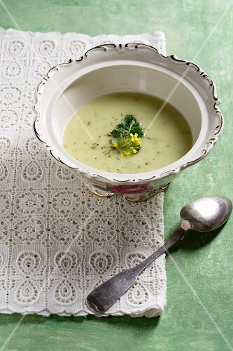 Cream of broccoli soup garnished with broccoli flowers