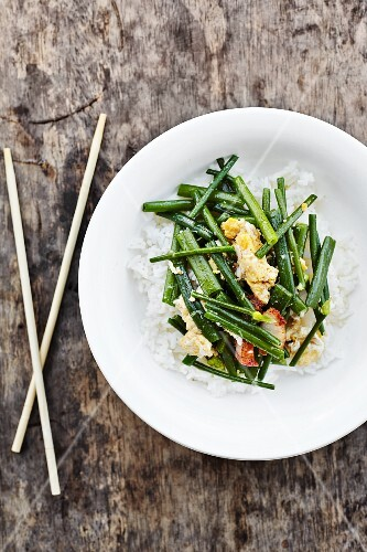 Pad-kha (onions stems with egg and pork belly, Thailand)