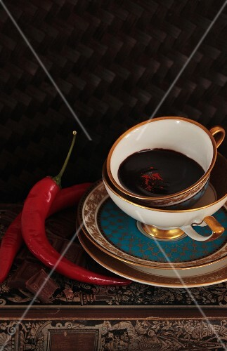 Dark chocolate in a cup with chilli powder