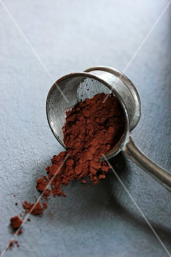 Cocoa powder in an old sieve