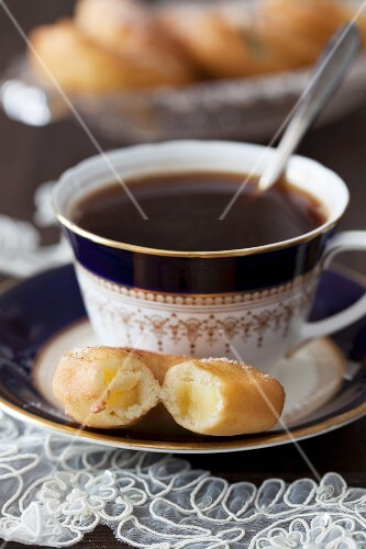 A cup of coffee and apple fritters