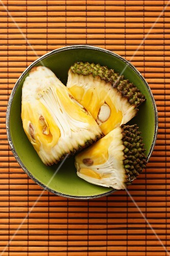 Three piece of jackfruit in a green bowl