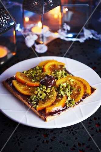 Chocolate tart with oranges and pistachio nuts