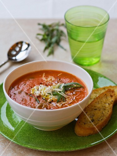 Tomato soup with tarragon and grated cheese