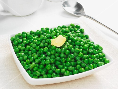 A bowl of peas with a knob of butter