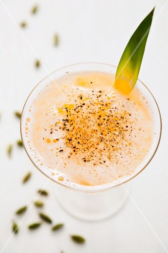A pineapple cocktail with cardamom