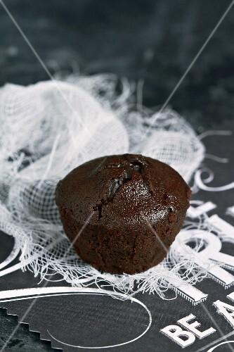A mini chocolate cake on a muslin cloth