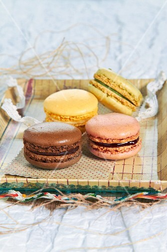 Four macaroons on a tray