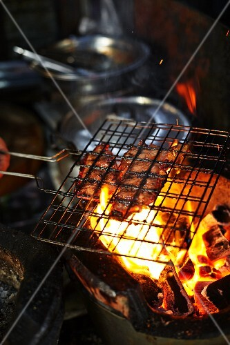 Chicken being barbecued