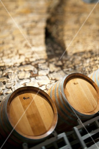 Wooden barrels in a natural stone arched cellar, Aargau