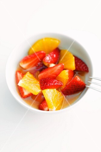 Fruit salad with marinated strawberries and oranges