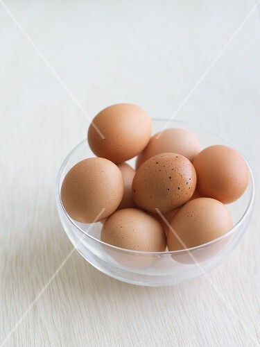Brown chicken eggs in a glass bowl