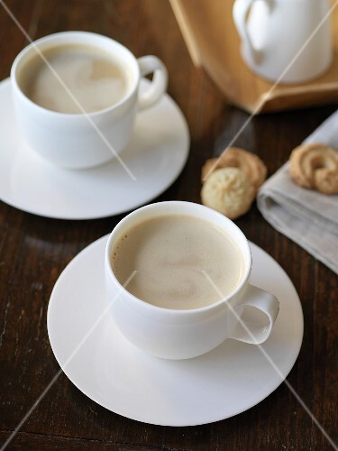Two cups of latte with milk foam