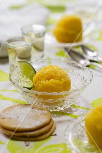 Orange and lime sorbet in glass bowls