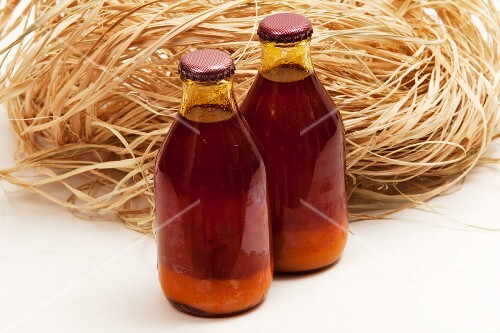 Two bottles of red palm oil