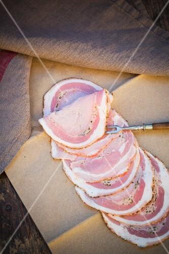 Slices of juniper berry ham