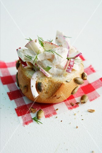 Pumpkin seed roll topped with smoked trout and apple salad