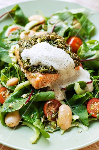 Salmon with sage pesto and lemon foam on a bed of spinach salad