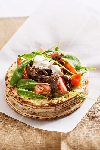 Tortillas with beef, tomatoes and sour cream