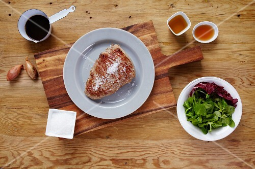 Roasted prime boiled beef on a white plate with salad