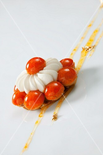 A Saint Honoré cake with a mandarin glaze