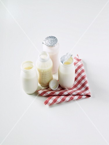 Various yogurt drinks on a checked napkin