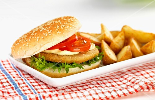 A chicken burger with potato wedges