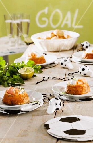 Cupcakes topped with smoked salmon and cream cheese for a football-themed party