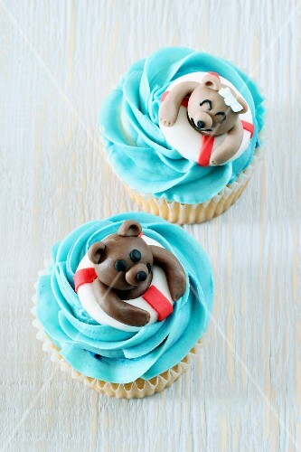 Coconut cupcakes decorated with swimming teddy bears