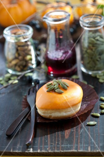 A doughnut filled with aronia jam