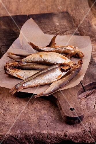 Smoked sardines on paper