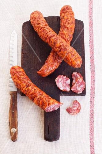 Dried Polish sausage on a chopping board