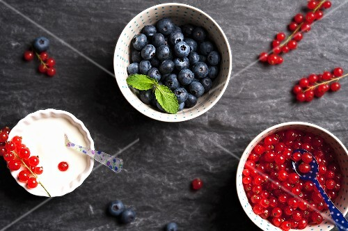 Fresh blueberries and redcurrants in bowls