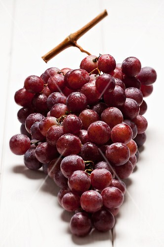 Red grapes with drops of water