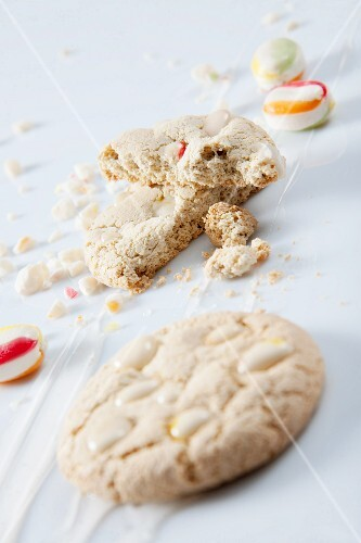 Two white chocolate chip cookies and bonbons