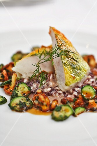 Monk fish wrapped in courgette flowers with port wine risotto, mini courgette and chanterelle mushrooms