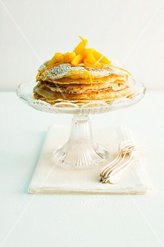 A crepes Suzette cake with an orange foam filling