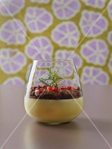 Crème brûlée with chocolate crumble and pomegranate seeds