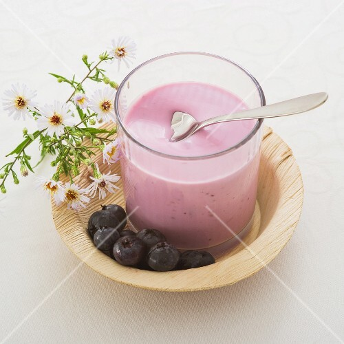A glass of blueberry yogurt