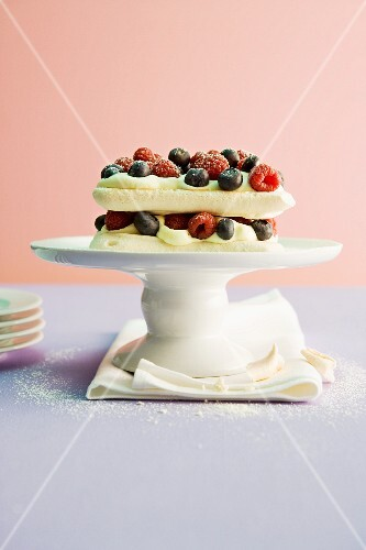 Meringue cake with passion fruit mousse and berries