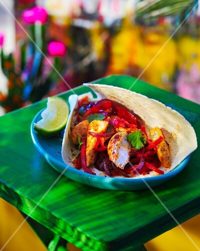 A fajita filled with chicken and peppers