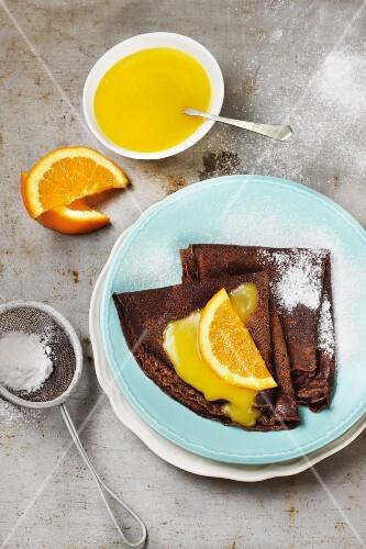 Chocolate pancakes with orange sauce