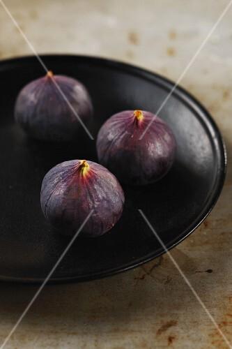 Three fresh figs on a plate