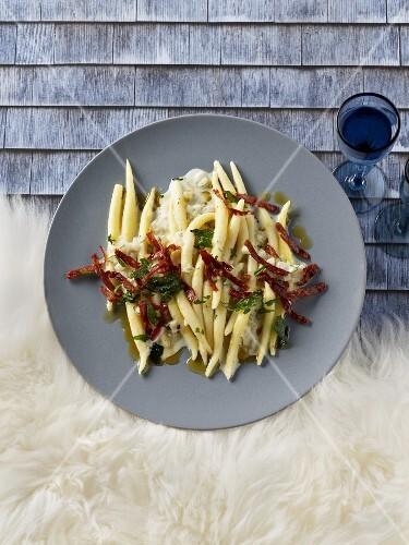 Potato pasta with strips of salami