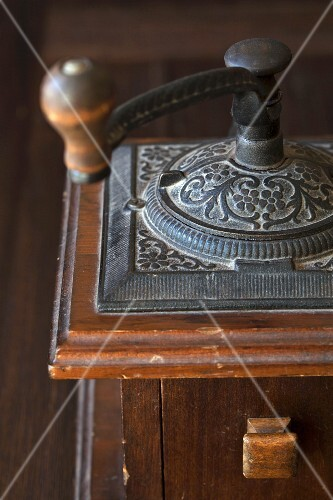 An antique coffee grinder