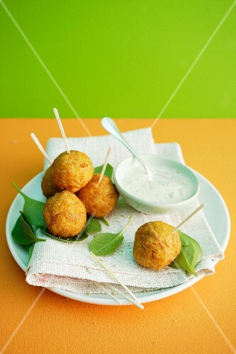 Baked carrot and sweetcorn balls with a yogurt dip
