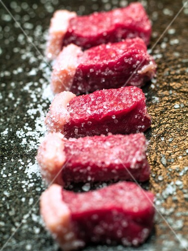 Picanha steak, sliced and salted