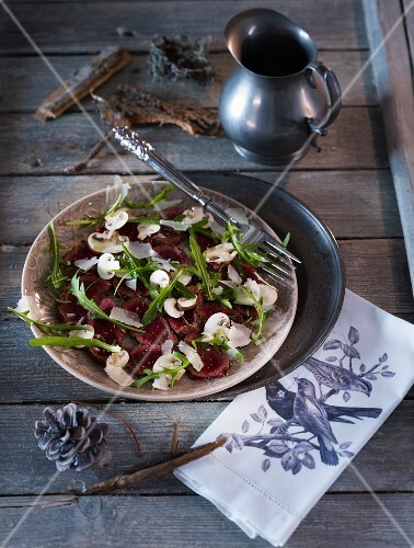 Venison carpaccio with mushrooms, rocket and Parmesan